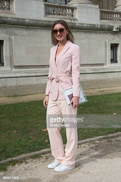 Fashion blogger Anna Rike who wears Celine sunglasses Zara trousers Beatrice B and Adidas shoes on day 5 of Paris Collections Women on March 07 2015...