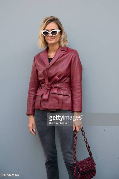 Fashion blogger AnneLaure Mais Adenorah wears a Ganni jacket Levis jeans vintage sunglasses on day 4 of London Womens Fashion Week Autumn/Winter 2017...