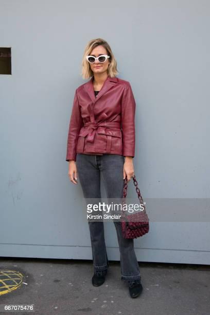 Fashion blogger AnneLaure Mais Adenorah wears a Ganni jacket Levis jeans vintage sunglasses Jonak shoes on day 4 of London Womens Fashion Week...