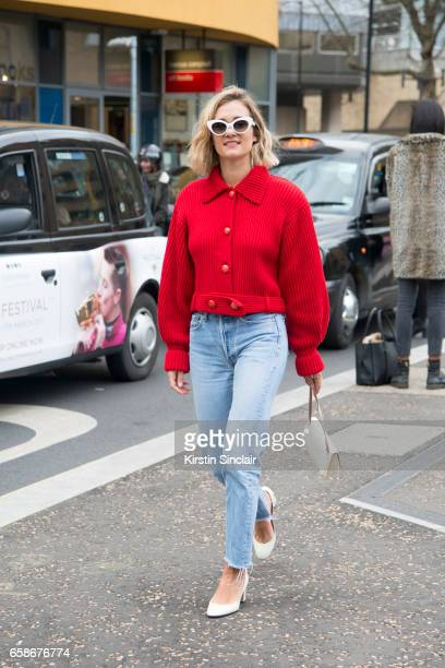 Fashion blogger AnneLaure Mais Adenorah wears a Karl Lagerfeld jumper Levi's Vintage jeans Valentino shoes And Other Stories bag on day 3 of London...