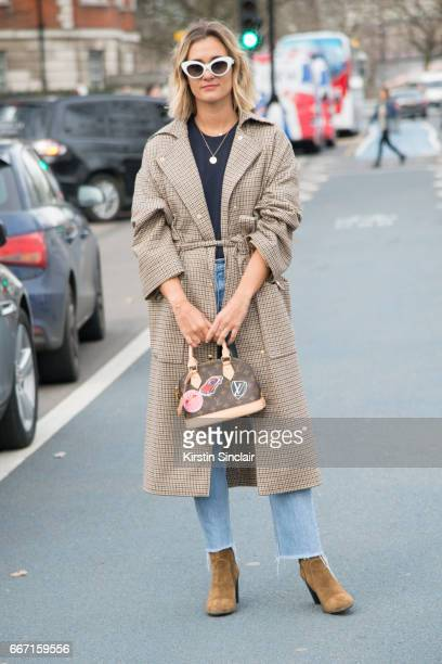 Fashion blogger AnneLaure Mais Adenorah wears Manouska trousers Louis Vuitton bag Levi'u2019s jeans JONAK shoes and vintage sunglasses on day 4 of...