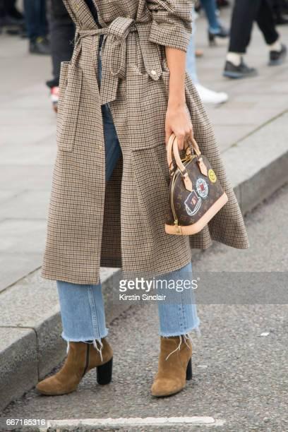 Fashion blogger AnneLaure Mais Adenorah wears Manouska trousers Louis Vuitton bag Levi'u2019s jeans JONAK shoes on day 4 of London Womens Fashion...