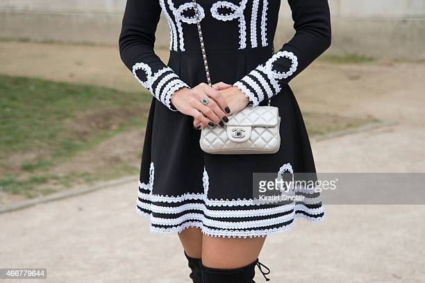 Fashion blogger Ariane Canovas wears a Bambola dress Chanel bag and Ray Ban sunglasses on day 8 of Paris Collections Women on March 10 2015 in Paris...
