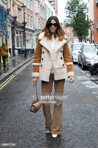 Fashion Blogger Atosa Nikkhah wears an Asos jacket Zara trousers Chloe bag Celine sunglasses and Topshop boots on day 1 during London Fashion Week...