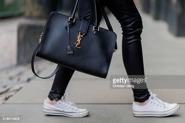 Fashion Blogger Barbora Ondrackova is wearing black Balenciaga leggings a black Yves Saint Laurent bag white Converse sneakers on April 1 2016 in...