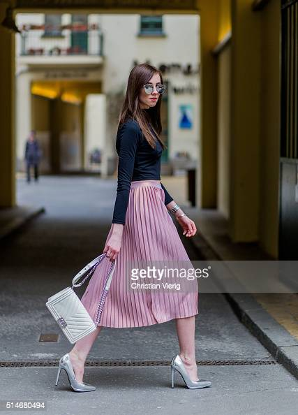 Fashion blogger Barbora Ondrackova wearing a black Topshop top a pink Asos skirt silver Asos heels a white Chanel bag silver Dior sunglasses on March...