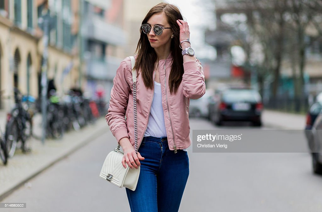 Fashion blogger Barbora Ondrackova wearing a pink Topshop bomber jacket blue Topshop denim jeans a white Chanel bag silver Dior sunglasses on March...