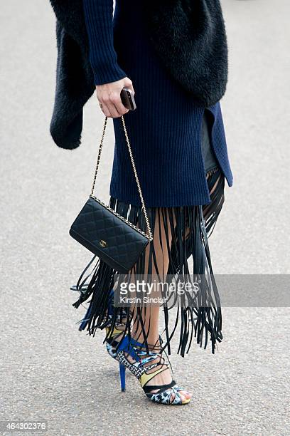 Fashion blogger Beau Mulder a Pink Yoto dress Zara shoes Chanel bag Zara scarf and SuperTrash skirt on February 23 2015 in London England