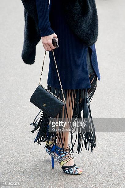 Fashion blogger Beau Mulder a Pink Yoto dress Zara shoes Chanel bag Zara scarf and SuperTrash skirt on February 23 2015 in London England