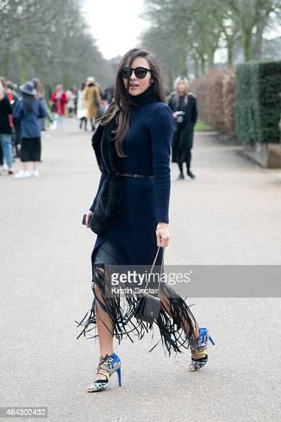 Fashion blogger Beau Mulder a Pink Yoto dress Zara shoes Chanel bag Zara scarf Celine sunglasses and SuperTrash skirt on February 23 2015 in London...