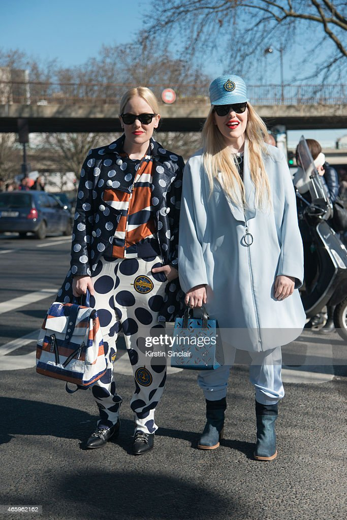 Fashion blogger Cailli Beckerman wears all Kenzo, Chanel boots, Kenzo bag and Ray Ban sunglasses. With Sam Beckerman wears all Kenzo and Guiseppe Zanotti shoes and Kenzo bag on day 6 of Paris Collections: Women on March 08, 2015 in Paris, France.