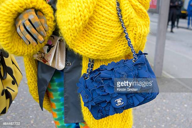 Fashion blogger Cailli Beckerman wears Mr Mittens jacket Sankuanz coat Chanel bag Etsy trousers on day 4 of London Collections Women on February 23...