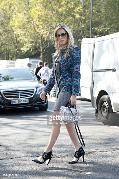 Fashion Blogger Camila Carril wears a Matthew Williamson dress Dior bag Jimmy Choo sunglasses and shoes and Gestuz top on day 6 during Paris Fashion...