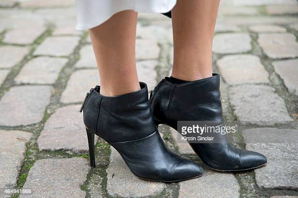 Fashion blogger Camila Carril wears French Connection boots on February 24 2015 in London England