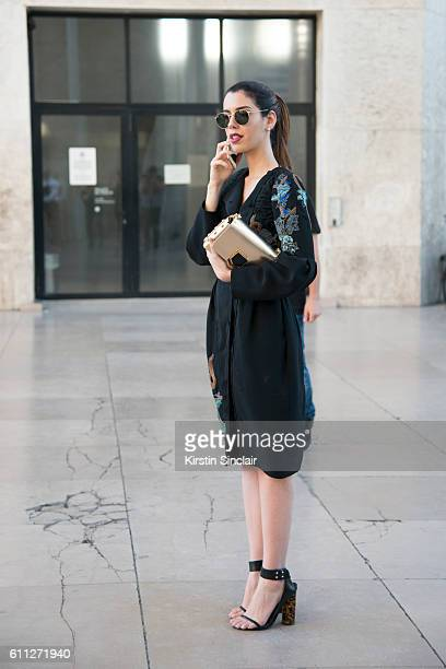 Fashion blogger Camila Coutinho wears a Guy Laroche dress Jimmy Choo bag and Animale shoes on day 2 of Paris Womens Fashion Week Spring/Summer 2017...