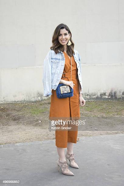 Fashion Blogger Camila Coutinho wears an Andrea Marques top and trousers Jimmy Choo bag Topshop jacket and Manolo Blahnik shoes on October 4 2015 in...