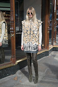 Fashion Blogger Camille Charriere is wearing Barbara Bui sleeveless jacket and boots Rag and Bone jeans and sunglasses and Chloe bag on day 3 of...
