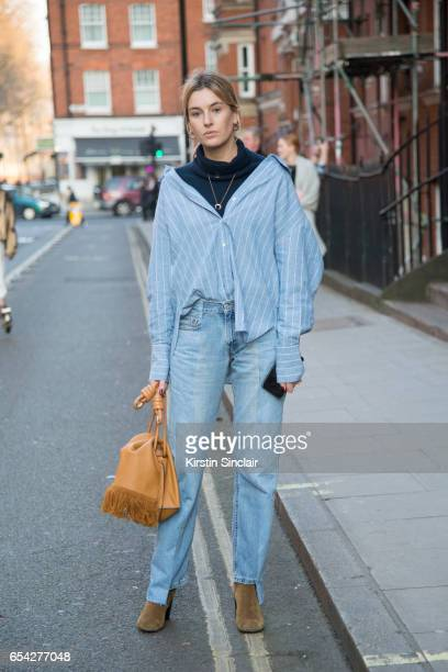 Fashion Blogger Camille Charriere wears a Lowe bag Rejina Pyo shirt on day 2 of London Womens Fashion Week Autumn/Winter 2017 on February 18 2017 in...
