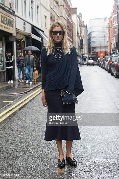 Fashion blogger Camille Charriere wears a Victoria Beckham skirt MarquesâAlmeida top Laurence Dacade shoes Stella McCartney necklace and Celine...