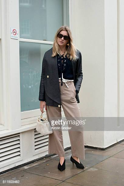 Fashion blogger Camille Charriere wears an Ann Sofie Back jacket Isabel Marant shirt Paul Smith belt Ganni trousers and Fendi bag on day 2 during...