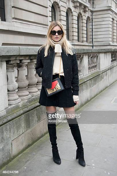 Fashion Blogger Camille Charriere wears Stuart Weitzman boots Rag and Bone jacket Christoph Lemer top and Celine bag and sunglasses on day 3 of...