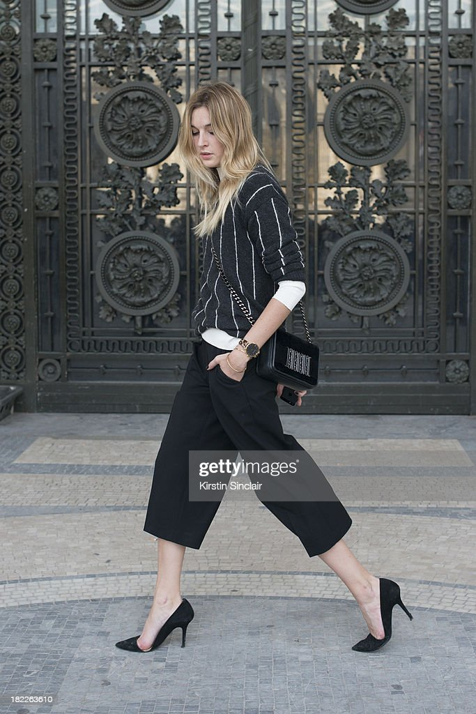 Fashion Blogger Camille Charriere wears Zara top and shoes, Club Monaco trousers, H and M bag and Mango knitwear on day 5 of Paris Fashion Week Spring/Summer 2014, Paris September 28, 2013 in Paris, France.