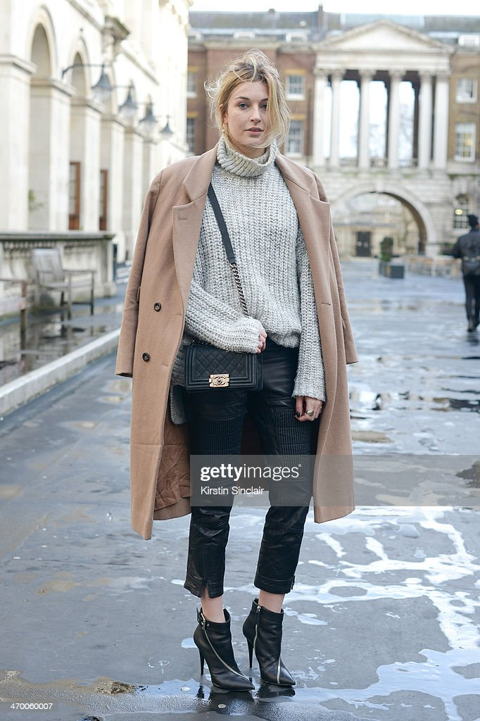 Fashion Blogger Camille Charrière wears H and M Paris Collection trousers Zara sweater Giuseppi Zanotti boots and Ganni coat on day 2 of London...