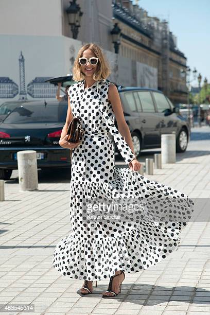 Fashion Blogger Candela Novembre wears an Antonio Marras dress Sergio Rossi shoes MSGM bag and Spektre sunglasses on day 2 of Paris Fashion Week...