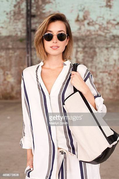 Fashion Blogger Carmen Hamilton wears a Basic top and trousers Balenciaga bag and Rayban sunglasses at MercedesBenz Fashion Week Australia 2015 at...