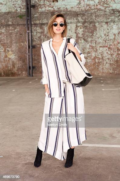 Fashion Blogger Carmen Hamilton wears a Basic top and trousers Chloe shoes Balenciaga bag and Rayban sunglasses at MercedesBenz Fashion Week...