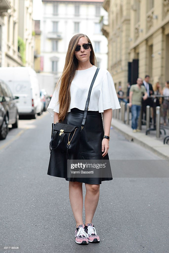 Fashion blogger Carola de Armas is seen wearing Zara top, H&M skirt, Zara shoes and Phillip Lim bag after Gucci show on June 23, 2014 in Milan, Italy.