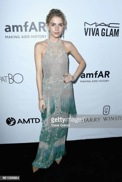 Fashion blogger Caroline Daur attends the amfAR Gala 2017 at Ron Burkle's Green Acres Estate on October 13 2017 in Beverly Hills California