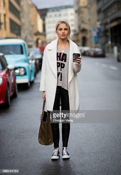 Fashion Blogger Caroline Daur is wearing a Goodlife sweater Balenciaga bag Converse shoes St Emilie pants and a ASOS coat on November 23 2015 in...