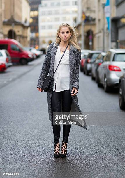 Fashion Blogger Caroline Daur is wearing a Noisy May blouse St Emilie pants Zara shoes on November 23 2015 in Berlin Germany