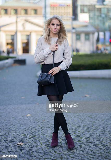 Fashion blogger Caroline Daur wearig Asos shoes Topshop skirt Zara sweater Calvin Klein bag poses November 9 2015 in Berlin Germany