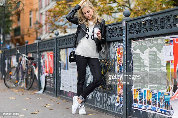 Fashion Blogger Caroline Daur wearing Noisy May pants Asos sweater Edited jacket Sandro bag and Adidas sneaker on October 17 2015 in Berlin Germany