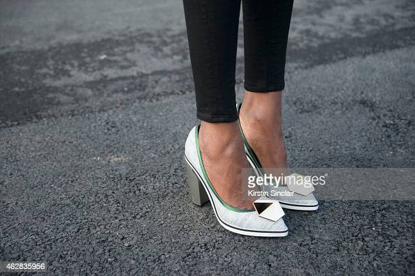 Fashion blogger Catherine Kallon wears Nicholas Kirkwood shoes J brand pants on day 3 of Paris Haute Couture Fashion Week Spring/Summer 2015 on...