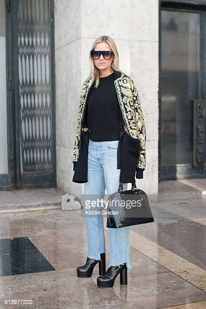 Fashion blogger Celine Aagaard wears Rochas jacket Louis Vuitton bag Vetements Jeans and shoes Celine top and sunglasses on day 2 during Paris...