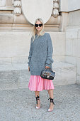 Fashion Blogger Charlotte Groeneveld wears a Chanel bag Celine sunglasses Jimmy Choo shoes Tome skirt and And Other Stories sweater on day 3 during...