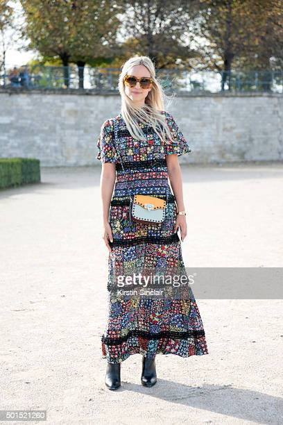 Fashion Blogger Charlotte Groeneveld wears a Valentino bag and dress Aldo boots and Chanel sunglasses on day 8 during Paris Fashion Week...