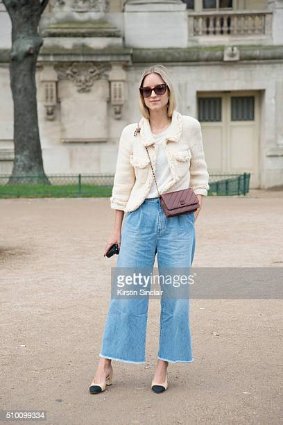 Fashion blogger Charlotte Groeneveld wears Rodebjer jeans Chanel jacket shoes and earrings on day 3 of Paris Haute Couture Fashion Week Spring/Summer...