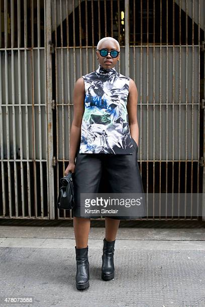 Fashion blogger Charnah Ellesse wears Lucilla Gray top and culottes vintage sunglasses Primark shoes and Zara bag on day 1 of London Collections Men...