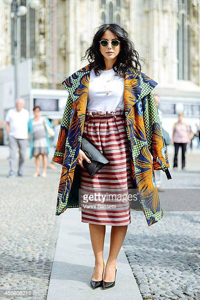 Fashion blogger Chiara Biasi poses in a Stella Jean coat and skirt Givenchy clutch and Phillip Lim shoes on September 17 2014 in Milan Italy