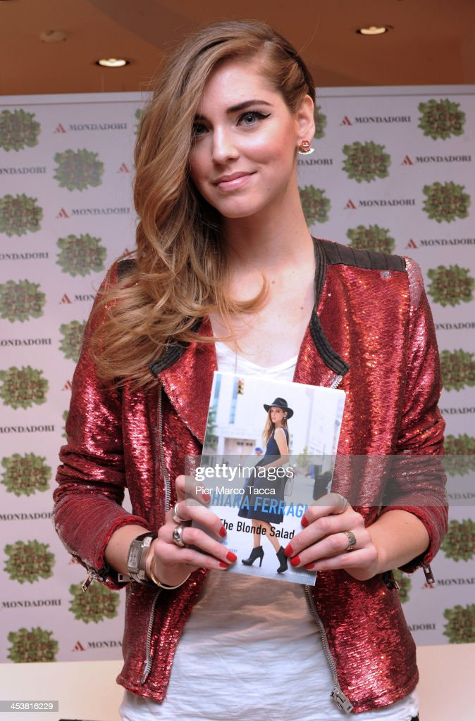 Fashion blogger <a gi-track='captionPersonalityLinkClicked' href=/galleries/search?phrase=Chiara+Ferragni&family=editorial&specificpeople=6755910 ng-click='$event.stopPropagation()'>Chiara Ferragni</a> attends a signing session for her book 'The Blonde Salad' at Mondadori on December 5, 2013 in Milan, Italy.