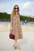 Fashion blogger Chiara Ferragni poses wearing a Rochas dress Chanel bag and Stella McCartney shoes on September 29 2014 in Paris France