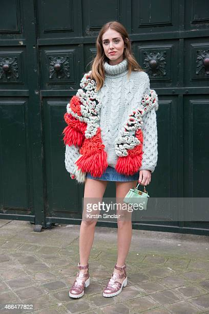 Fashion blogger Chiara Ferragni wears a Delpozo sweater Fendi bag vintage denim shirt Chiari Ferragni Collection shoes on day 7 of Paris Collections...