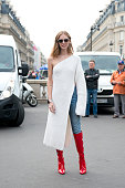Fashion Blogger Chiara Ferragni wears her own design boots and a Stella McCartney sweater dress on day 7 during Paris Fashion Week Spring/Summer...
