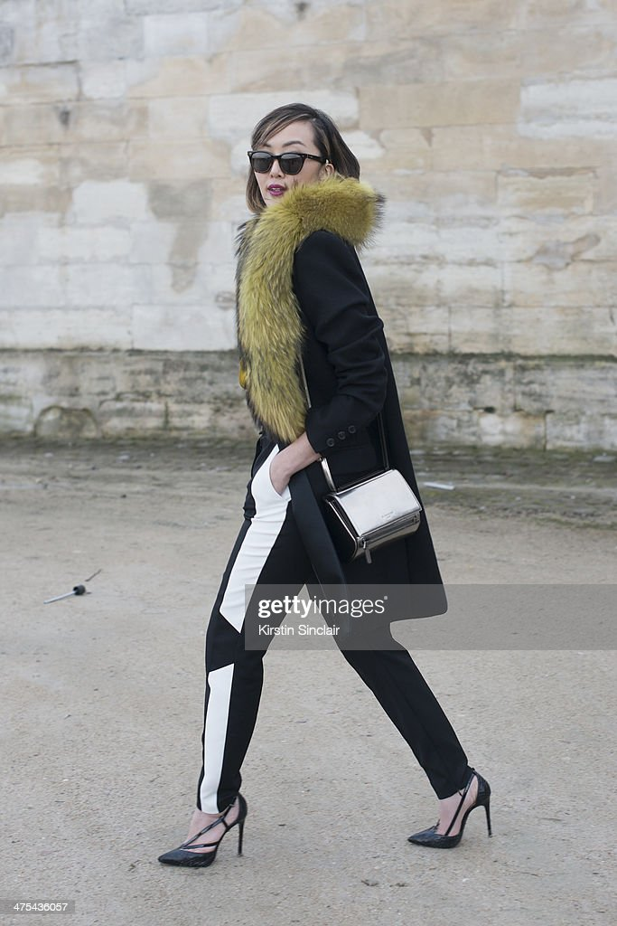 Fashion Blogger Chriselle Lim wears a Givenchy purse, Toms sunglasses and everything else Barbara Bui on day 3 of Paris Collections: Women on February 27, 2014 in Paris, France.