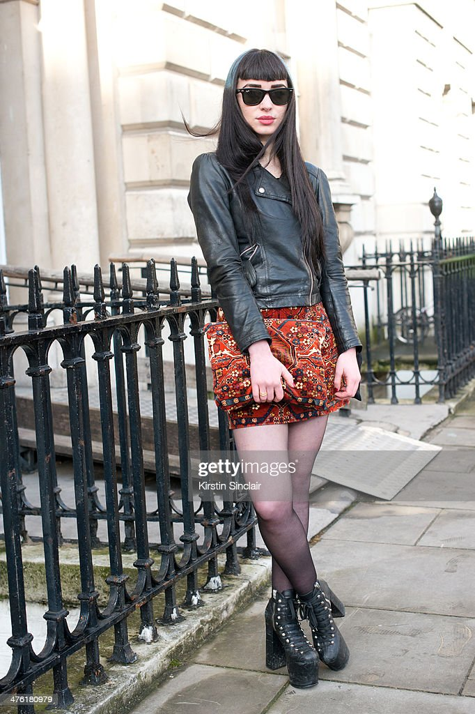 Fashion Blogger Christina John-Rockett wears a Topshop Jacket, House of Hackney skirt and clutch, Unif shoes and Rayban sunglasses on day 5 of London Collections: Women on February 18, 2014 in London, England.