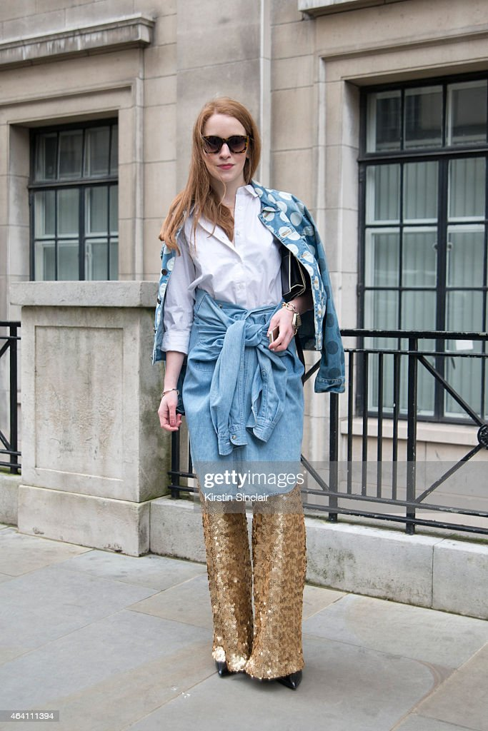 Fashion Blogger Chrsity Stankveyute wears a House of Holland jacket,, Front Row shop white shirt, Vintage denim shirt, Zero UV sunglasses, And Other Stories bag and Asos trousers on February 21, 2015 in London, England.